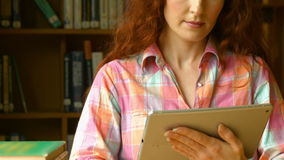 Student using a tablet pc. At the desk stock footage