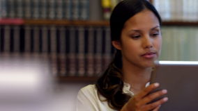 Student using tablet pc in library. In ultra hd format stock video footage