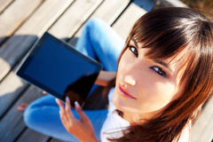Student Using Tablet PC In The Nature Stock Photos