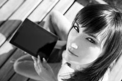 Student Using Tablet PC In The Nature Royalty Free Stock Photo