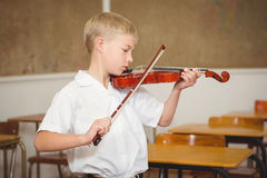 Student using a violin in class Stock Images