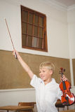 Student using a violin in class Royalty Free Stock Photography
