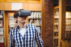 Student using virtual reality headset. In library at college Stock Photos