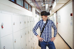 Student using virtual reality headset in locker room. At college Stock Photo