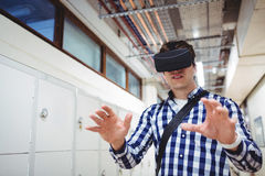 Student using virtual reality headset in locker room. At college Stock Photos