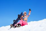 Student on vacation with snowboards Royalty Free Stock Photos