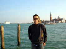 Student in Venice. Young man visiting laguna in Venice Royalty Free Stock Photos