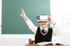 Student with virtual reality headset sitting in classroom. Happy student with virtual reality headset sitting in classroom stock image