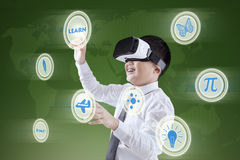 Student with VR headset and virtual screen. Portrait of a little boy using a virtual screen while wearing virtual reality headset Stock Image
