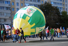 Student walk with a huge balloon. Stock Photo