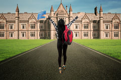 Student walk to campus rear view Royalty Free Stock Photography