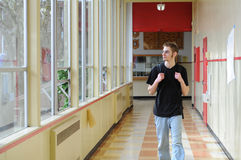 Student walking in hallway Royalty Free Stock Photo