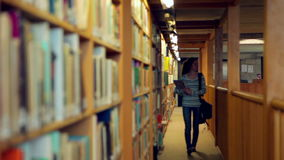 Student walking through the library Stock Image