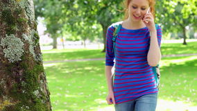 Student walking and making a call stock footage