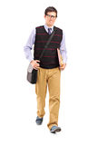 Student walking with notebooks in his hand. Full length portrait of a student walking with notebooks in his hand  on white background Royalty Free Stock Photos