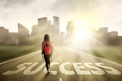 Student walking on the success way Royalty Free Stock Image