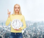 Student with wall clock and finger up Royalty Free Stock Images