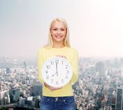 Student with wall clock Royalty Free Stock Image