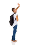 Student waving goodbye. Pretty african college student waving goodbye isolated on white background royalty free stock image