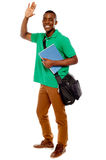 Student waving his hands. Enjoying himself Royalty Free Stock Image