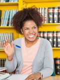Student Waving While Looking Away In College Stock Image