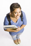 Student wearing backpack carrying books Stock Photo