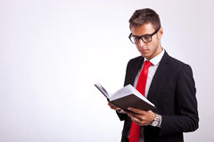 Student wearing glasses and reading a law book Stock Image
