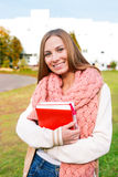 Student wearing scarf. And standing on building background royalty free stock photos