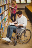 Student in wheelchair talking with classmate Stock Photos