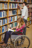 Student in wheelchair talking with classmate Royalty Free Stock Photo