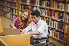 Student in wheelchair working with a classmate Stock Photos