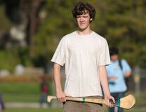 Student in white shirt 2 practicing hurling Stock Photography