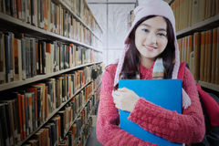 Student with winter clothes in library Royalty Free Stock Photos