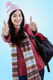 Student in winter clothes showing thumbs-up Royalty Free Stock Photos