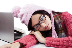 Student in winter clothes sleeping on table Royalty Free Stock Images