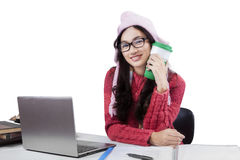 Student in winter clothes studying on table Royalty Free Stock Image