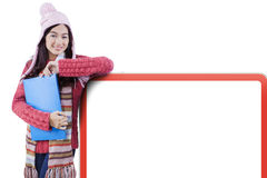 Student with winter clothes and whiteboard Stock Image