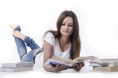 Student woman lying and reading a book. Beautiful 18 Year Old Teen Girl Reading Book Stock Photography
