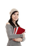 Student woman. Young student woman holding a book, isolated on white Royalty Free Stock Images