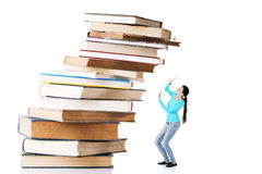 Student woman afraid of pile of books. Isolated on white background. Learning problem and exam concept Royalty Free Stock Photos
