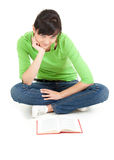Student woman with book sitting on the floor Royalty Free Stock Photography
