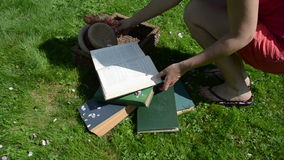 Student woman books grass