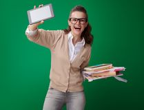 Student woman with books, notes and records and tablet PC. Happy young student woman with books, notes and records and tablet PC showing the convenience of royalty free stock photo