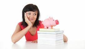 Student woman with books and piggy bank Royalty Free Stock Photo