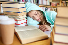 Student or woman with books sleeping in library Stock Images