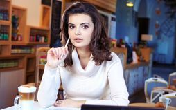 Student woman in cafe Royalty Free Stock Image
