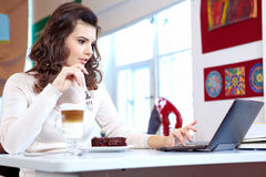 Student woman in cafe Stock Images