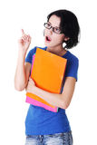 Student woman with coloured note pad pointing up. Stock Images