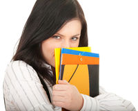 Student woman covering face by note pad Stock Images
