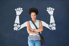 Student woman with fists graphic standing against blue blackboard Royalty Free Stock Image
